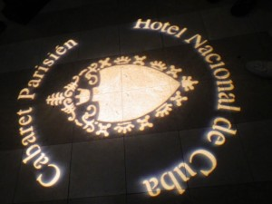 This logo was projected in lights on the dark floor at the entrance to Cabaret Parisien
