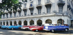 Old cars, most used as taxis, line up outside our downtown Havana hotel