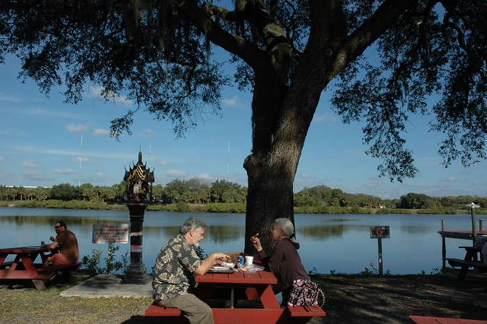 A picnic table next to the Palm River is one of the best places to enjoy the food purchased.