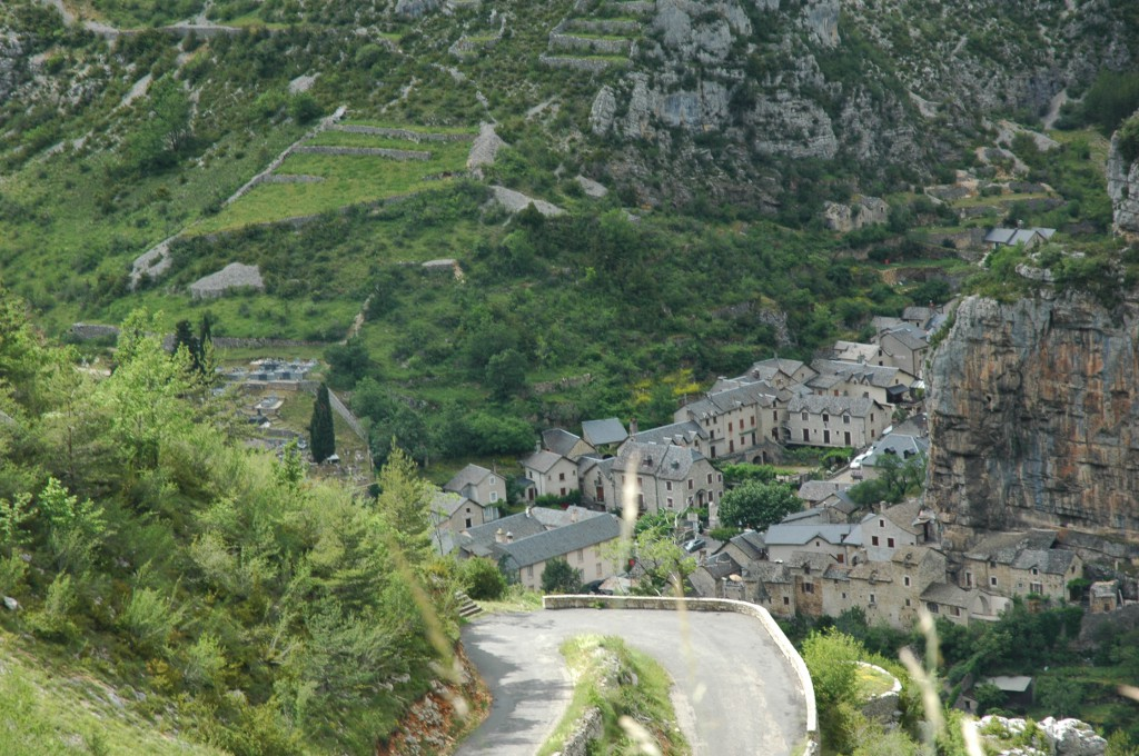 A stone village in Lozère recedes beneath us as our vehicle climbs a road carved from a one-time animal track.