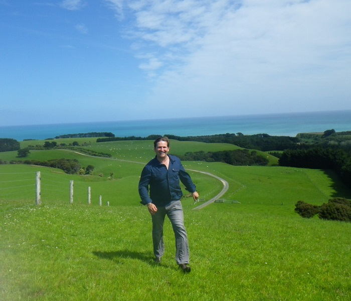 Nic DeLange welcomes us to his 5,500 acre country estate Wharekauhau, about two hours from Wellington, New Zealand.His sheep are the white dots in the background.