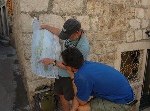 Our guides look over a map to decide our next port and the adventures possible there.